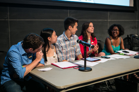 Student poets on a panel table having a discussion.