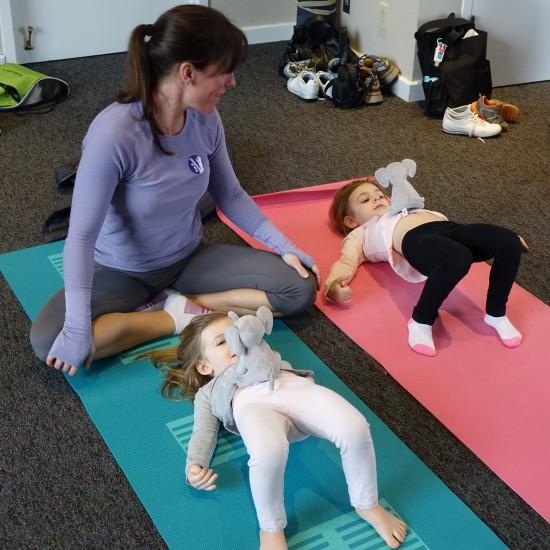 Children practicing the yoga bridge pose