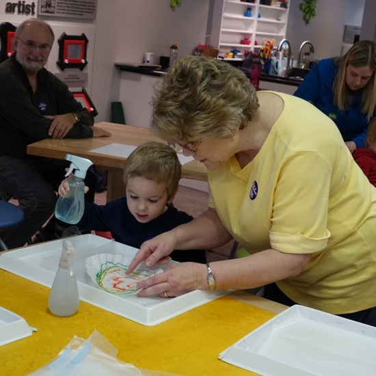 A child participating in arts and crafts