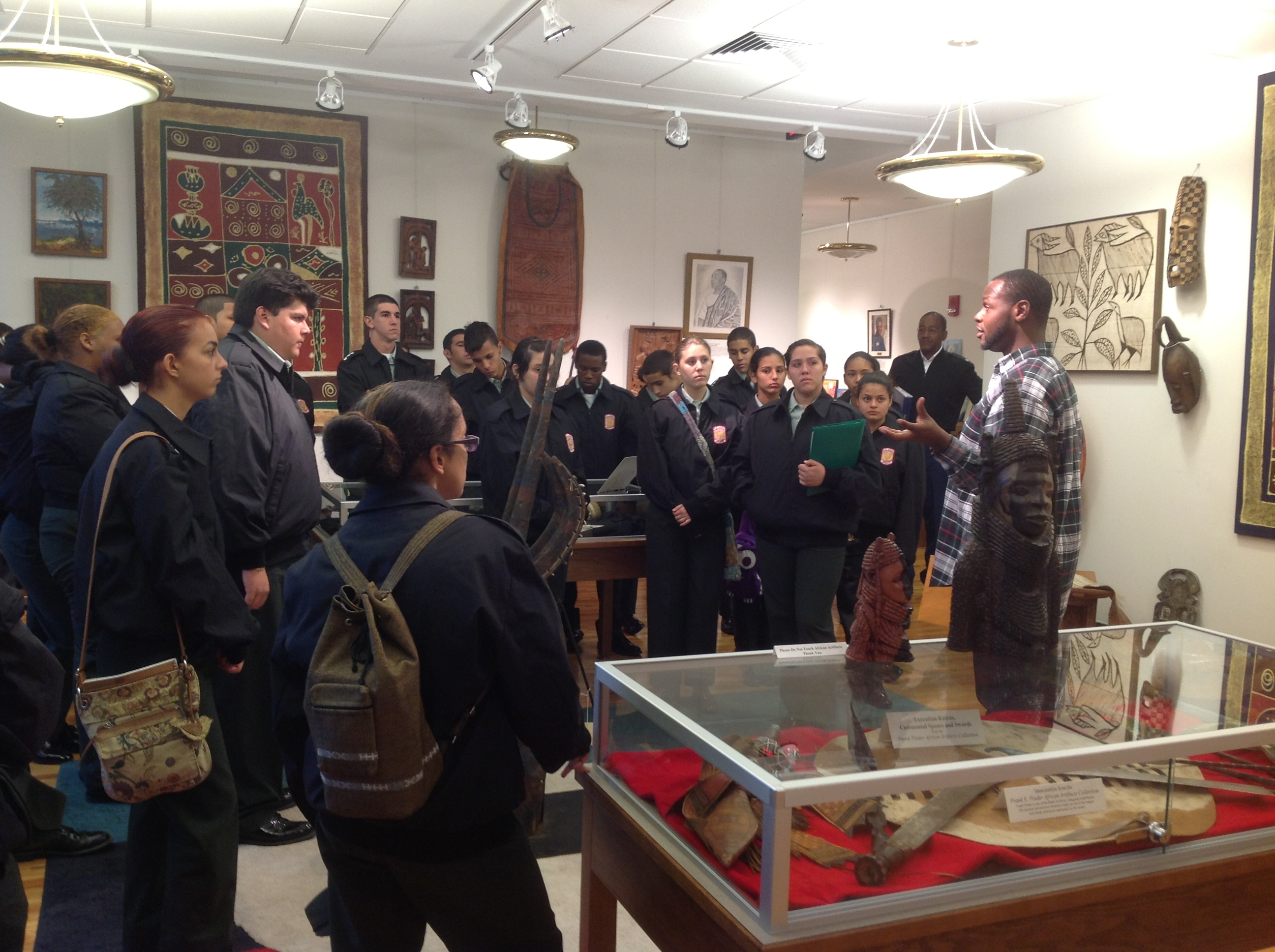 I AMM Fellow gives a tour to students visiting the museum.