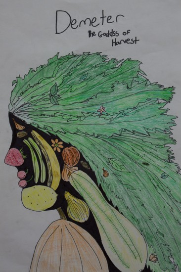A drawing of a fruit face created by summer camp children.