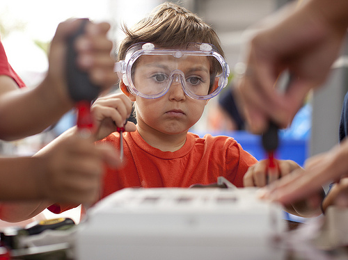 photo of a boy using tools at Maker Faire