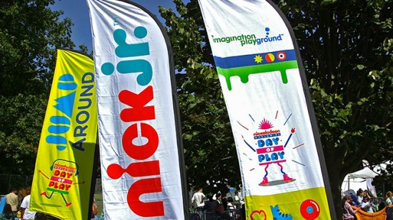 Nickelodeon signs at the Worldwide Day of Play event.