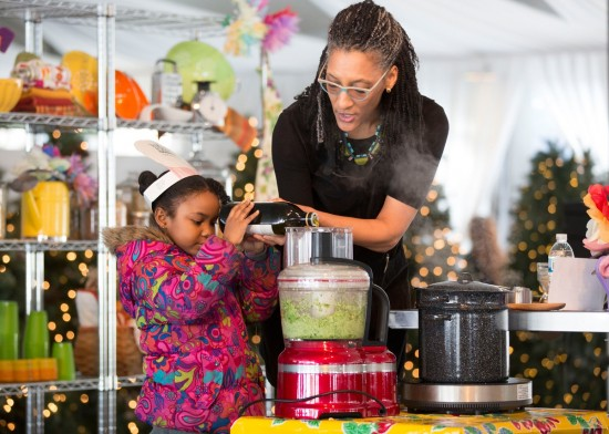 Carla Hall receives help from an aspiring young chef for a delicious—and healthy!—broccoli pesto.]