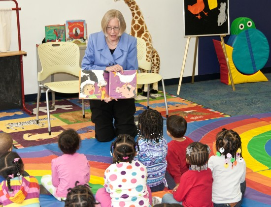 Susan reading a book to children