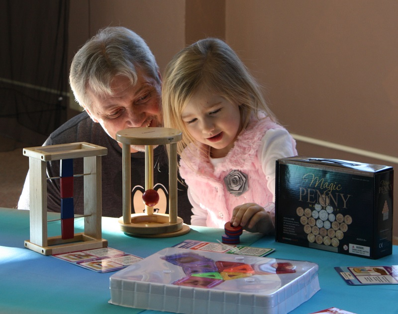 Grandparent and child participating in library activity
