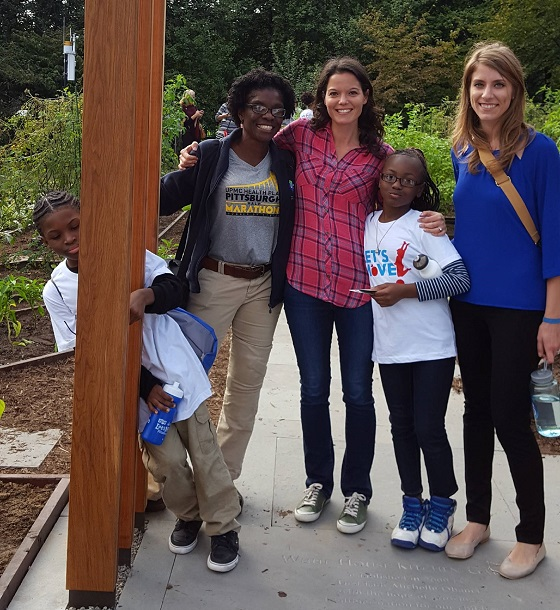 two students, the physical education teacher at Urban Pathways, Let's Move! Director, in the White House garden with Let's Move Pittsburgh Program Director.