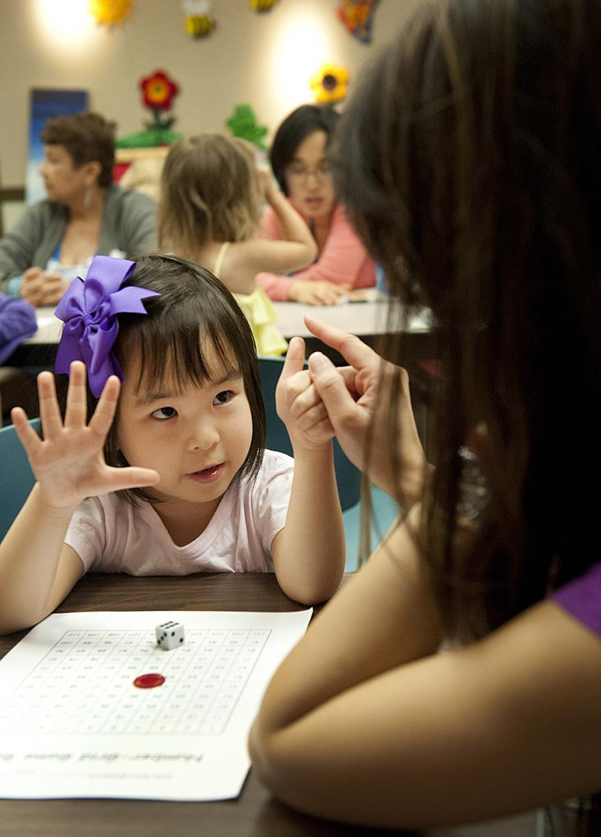 Pre-school student counts with fingers