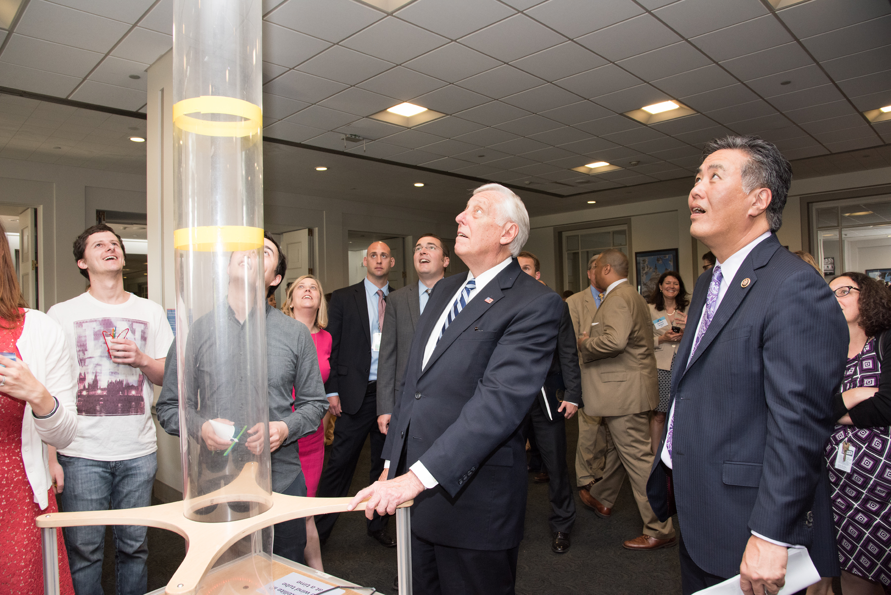 Representatives Steny Hoyer (left) and Mark Takano (right) enjoy the Museum of Science, Boston's Faire activity.