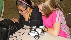 Cheyenne Bailey and Brylee Eagar participate in a LEGO robot session