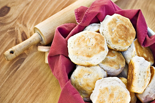 Biscuits in a bowl with rolling pin