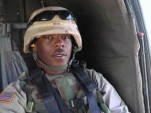 Private Michael Davis Jr. in a Blackhawk helicopter.