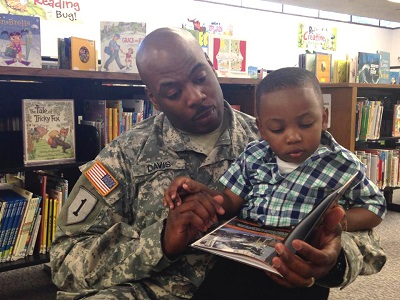 Staff Sgt. Michael Davis Jr. reads to his son.