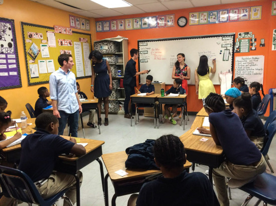 Student poets in an elementary school classroom teaching kids about poetry.