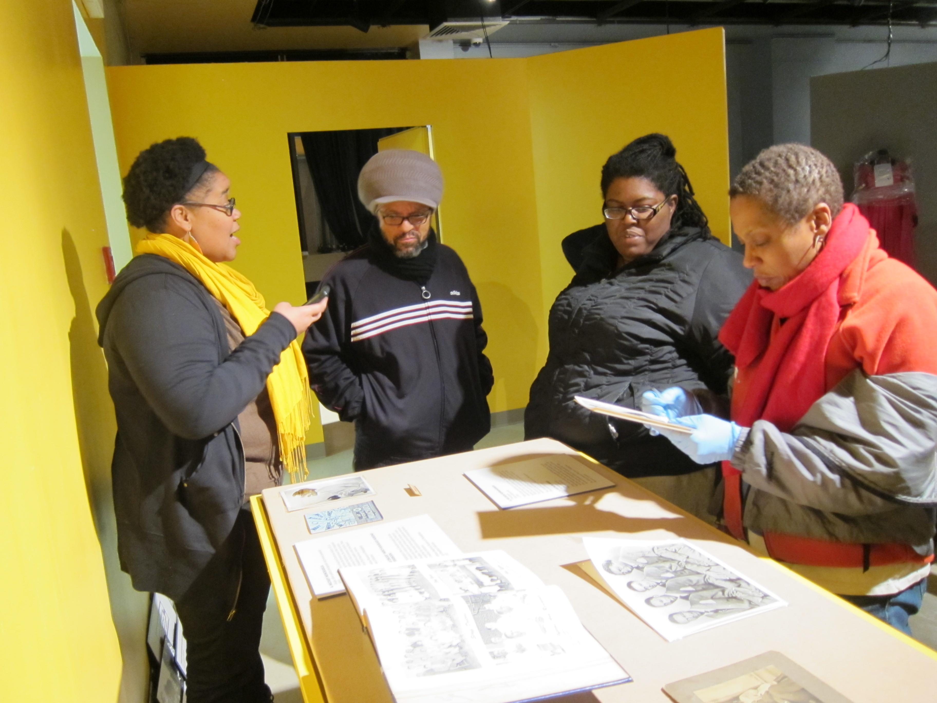 AAMP curatorial assistants working on the exhibit