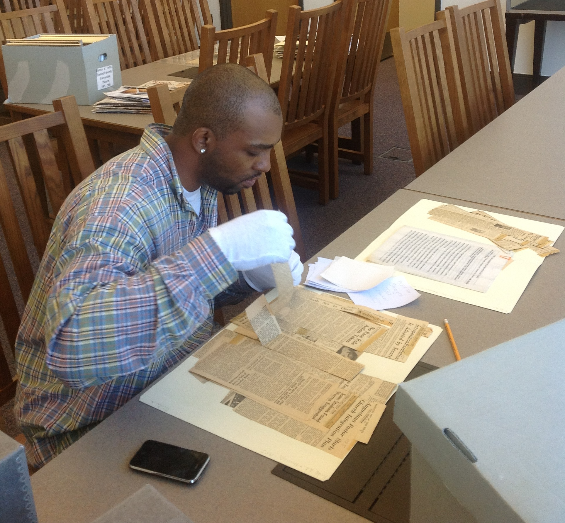 I AMM Fellow Anthony Thompson browses archival material.