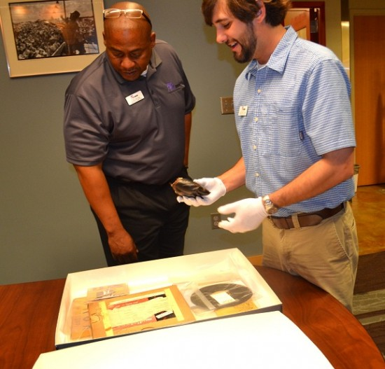 Dion Brown and James McWilliams examine a piece in the museum
