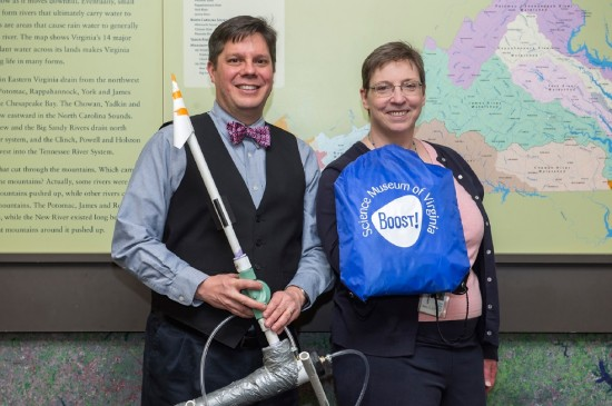 Presenter Chuck English, Science Museum of Virginia, and Enid Costley, Library of Virginia, holding a kit with activities related to the museum's Boost! exhibit.