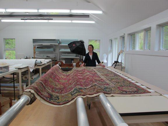 Large Persian rug in lab for conservation treatment