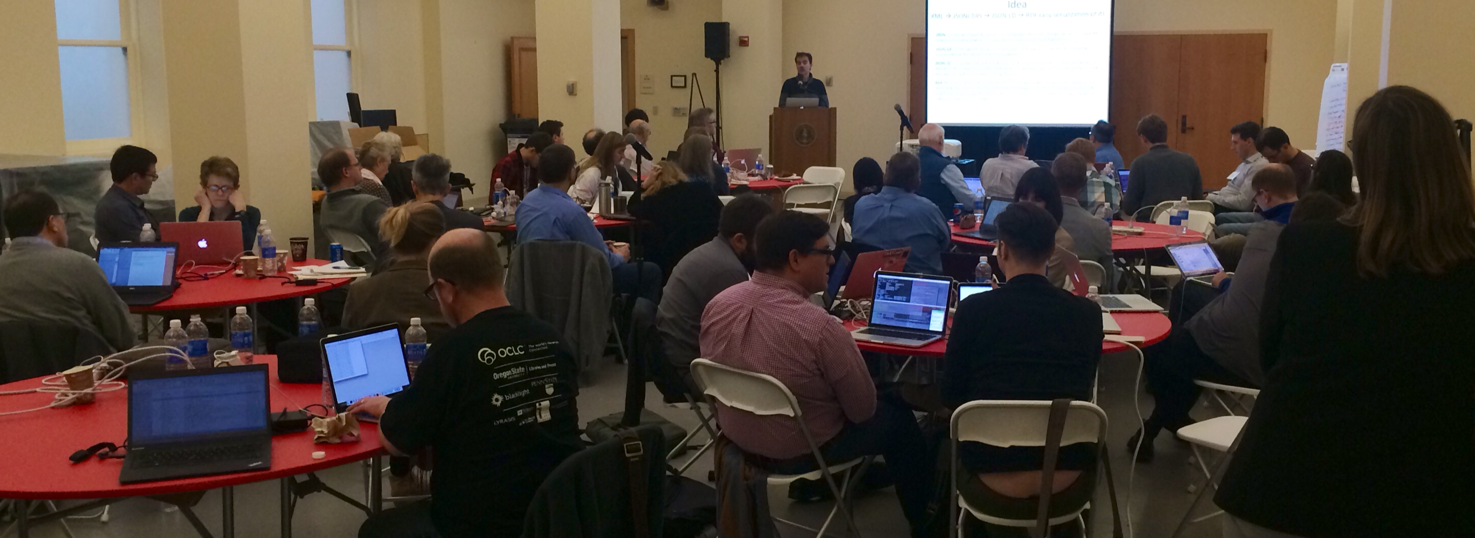 people in a conference room participating in the linked data conference.