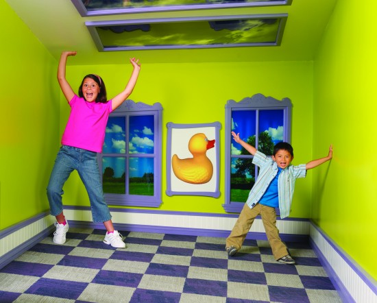 Kids playing at an exhibit at The Strong
