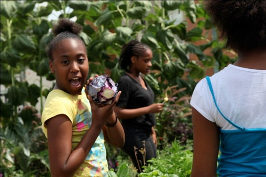 Girl holds cabbage at the Phipps Conservatory and Botanical Garden