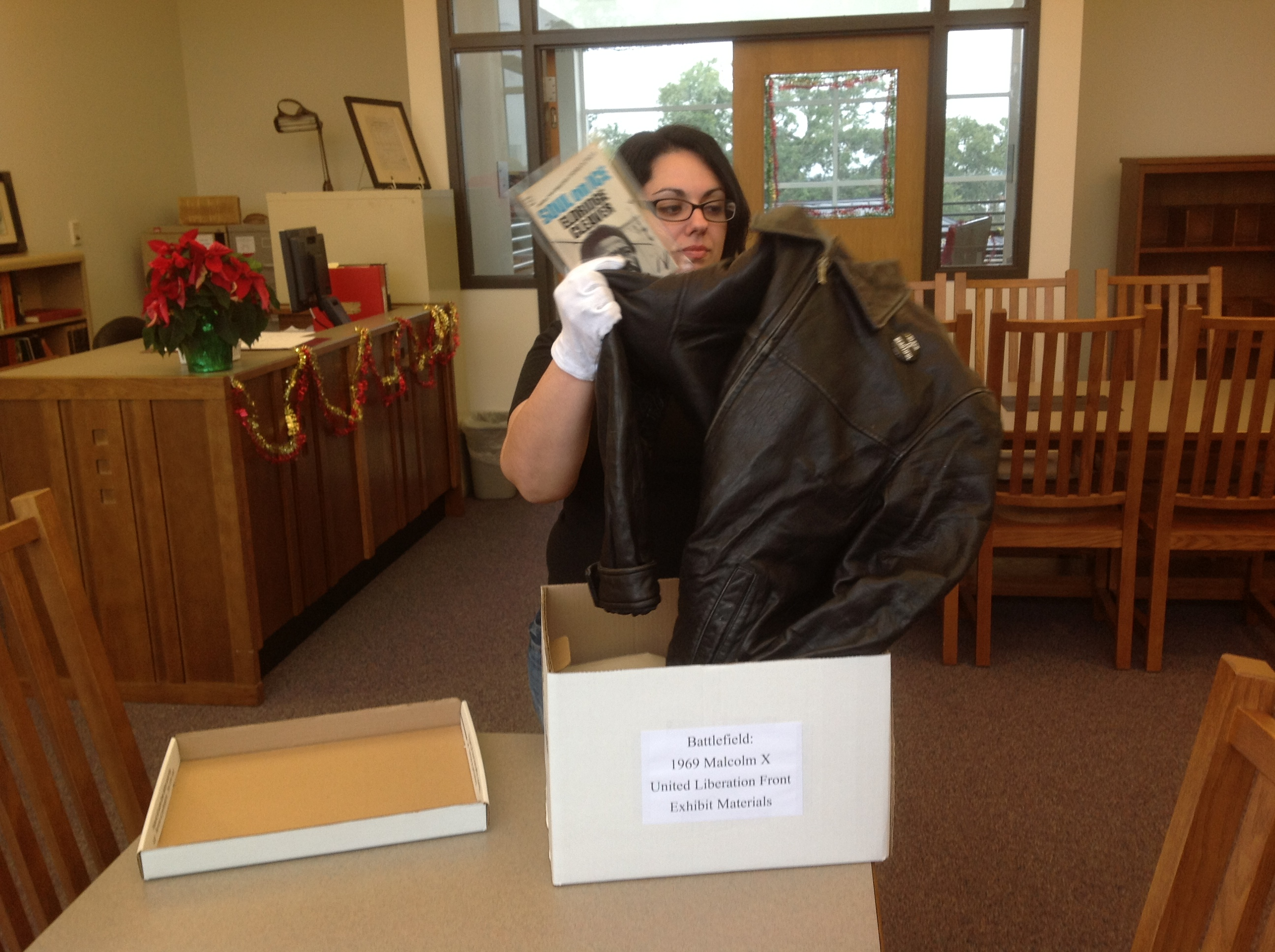I AMM Fellow Lorraine Rossi unpacks a leather jacket that will be used for a Black Panther display.