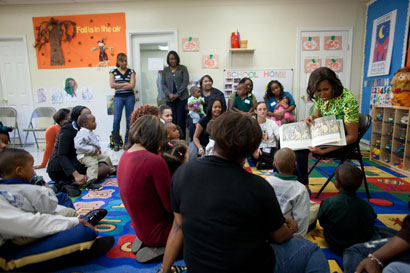 Photo of Mrs. Obama reading to children.