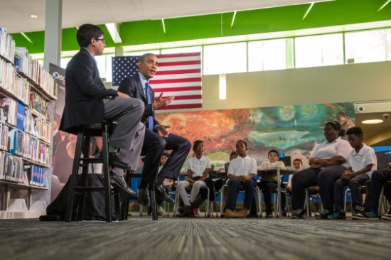 """President Barack Obama answers questions from students during the Discovery Education webinar entitled """"Read to Discover a World of Infinite Possibilities,"""" at the Anacostia Neighborhood Library in Washington, D.C., April 30, 2015. 6th-grader Osman Yaya moderates the event which is part of the """"Of the People: Live from the White House"""" Virtual Field Trip series. (Official White House Photo by Chuck Kennedy)"""
