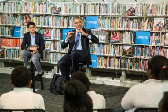 """President Barack Obama answers questions from students during the Discovery Education webinar entitled """"Read to Discover a World of Infinite Possibilities,"""" at the Anacostia Neighborhood Library in Washington, D.C., April 30, 2015. 6th-grader Osman Yaya moderates the event which is part of the """"Of the People: Live from the White House"""" Virtual Field Trip series. (Official White House Photo by Pete Souza)"""