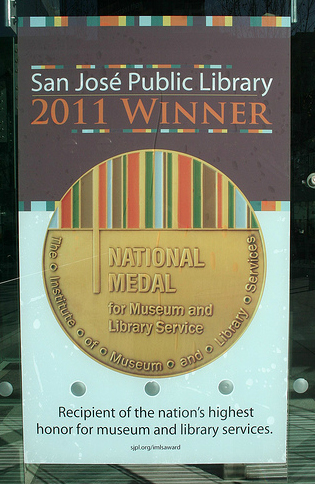 photo of poster at the San Jose public library annoucing the 2011 national medal