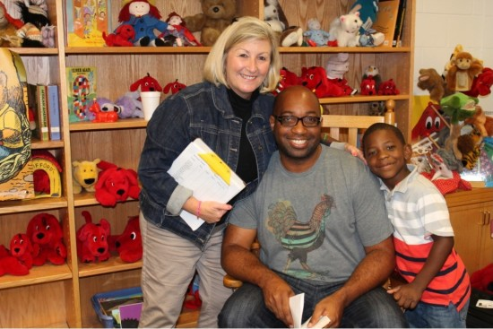 Teacher Sally Prickett poses with Kwame and one of her students.