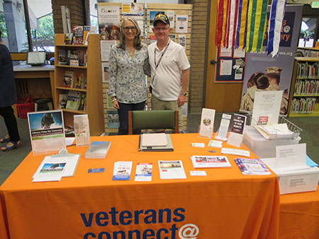Evelyn Figeroid, Branch Veteran Resource Station Coordinator and Bill Mattingly, volunteer and Vietnam veteran.