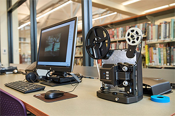 CCPL's new Jack, Joseph and Morton Mandel Memory Lab allows residents to digitize film and photography while working on family histories.