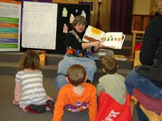 local librarian conducting an Every Child Ready to Read workshop with kids and parents