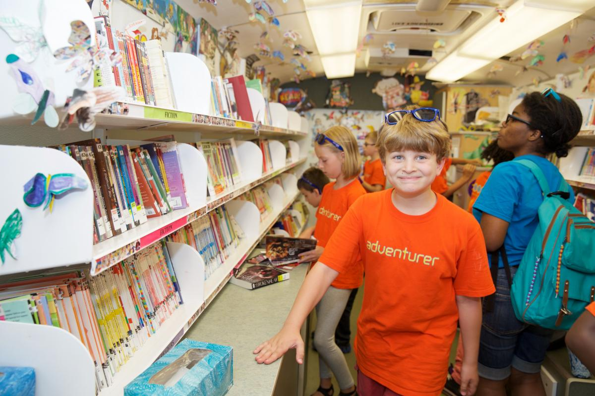 a boy age 11 explores a bookmobile