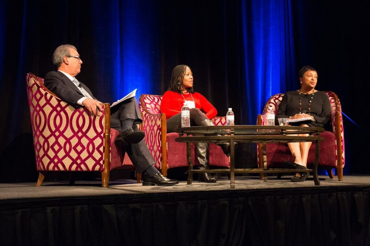 Plenary panel with Luis Herrera, Melanie Adams, and Carla Hayden.