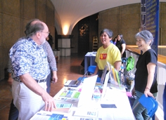 Governor Neil Abercrombie visiting the Hawaii State Public Library System's resource table
