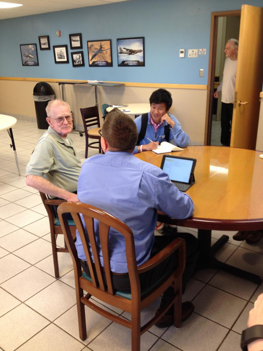 (Photo Courtesy of National Student Poets Program: NSPP's David Xiang and Jason Poudrier interviewing one of the veterans with dementia, recording his story for the family and posterity.)