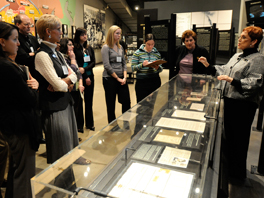 Image of a group of professionals listening to a museum guide