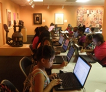 students use computers in the museum