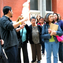 A group of immigrant adults attending a tour at the Queens Museum of Art.