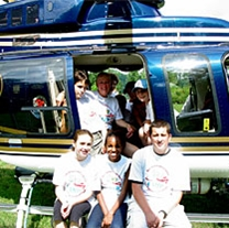 Sky Camp particpants pose in front of a state police helicopter.