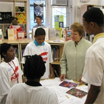 Anne-Imelda Radice, IMLS Director, with students from the Stuart-Hobson Middle School.