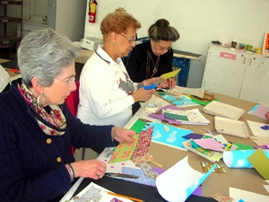 three class participants create art projects