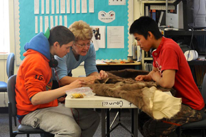 High school students working on a portion of the parka