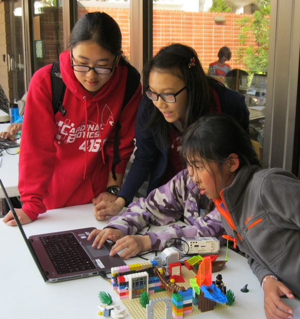 Older students participate in a Lego Mindstorm challenge at the San Francisco Public Library.