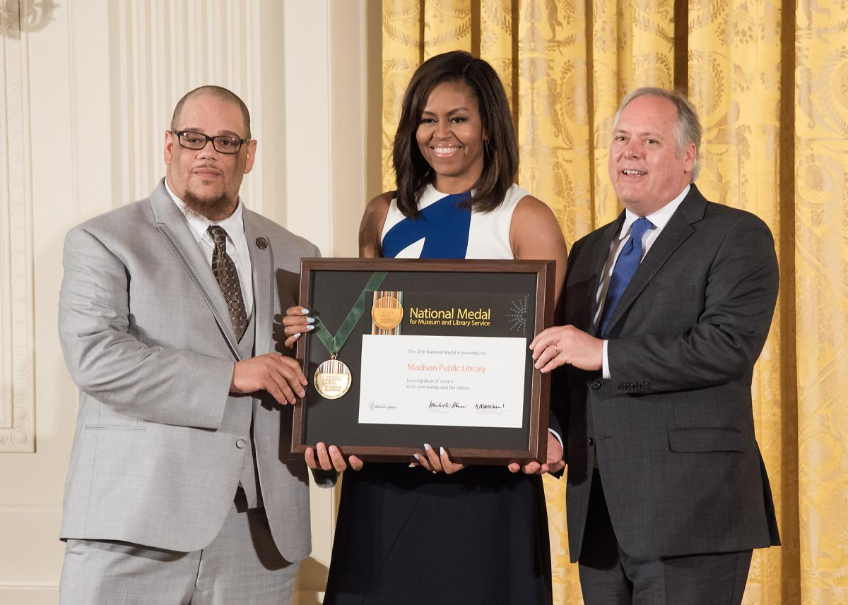 Community member Rob Franklin and Madison Public Library Director Greg Mickells celebrate after accepting the award, presented by First Lady Michelle Obama.