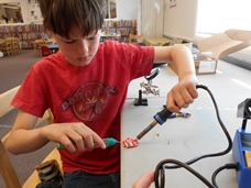 youth participant actively using one of the Make It at the Library program's maker spaces