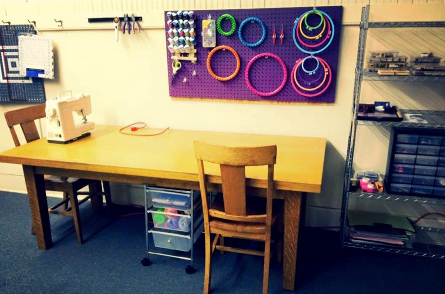 makerspace with work table, sewing machine and supplies